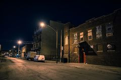 Dark and scary urban industrial city district at night. Dark and scary Chicago urban industrial city district at night Stock Image