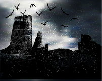 Dark scary winter landscape with silhouette of castle, birds and snow Royalty Free Stock Photography