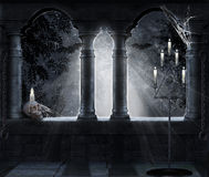 Dark scene. Night scene of a medieval castle with skull and candles Royalty Free Stock Photos
