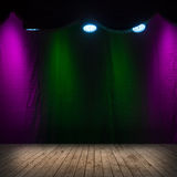 Dark scene interior with spotlights. Wooden stage and colorful background Stock Photo