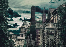 Dark Scene Medieval Style Houses. Dark scene night village digital manipulated and color edited photograpy of medieval houses with plants and trees around and Stock Photo