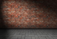 Dark scene with spotlight on red brick wall background Stock Photography