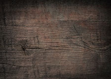 Dark scratched grunge cutting board. Stock Images
