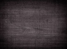 Dark scratched grunge cutting board. Stock Image