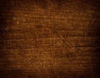 Dark scratched grunge cutting board. Stock Photo