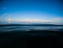 Dark sea and deep blue sky. Double landscape with sea water and sky.