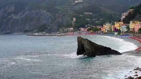 Dark sea and mountains with beach and buildings in Monterosso al Mare