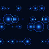 Dark seamless background with shinning blue circles and points Royalty Free Stock Images
