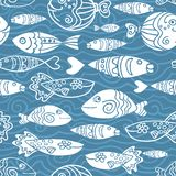 Dark  seamless pattern with hand drawn funny fishes and waves in sketch style. Decorative endless marine background. Fabric. Dark  seamless pattern with hand Royalty Free Stock Images