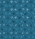 Dark seamless pattern of many light snowflakes on blue backgroun. D. Soft Christmas winter theme for gift wrapping. New Year seamless background for website Royalty Free Stock Image