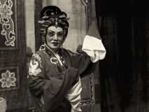 Dark sepia version of an elderly Chinese Teochew opera singer perform Royalty Free Stock Photography
