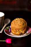 A dark set for a gluten free muffin Royalty Free Stock Photography