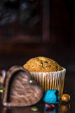 A dark set for a gluten free muffin Royalty Free Stock Photos