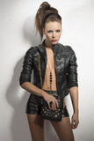 Dark fashion brunette with leather clothes Stock Photography