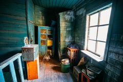 Dark and shabby messy room in poor apartment of old emergency abandoned wooden house, poverty concept