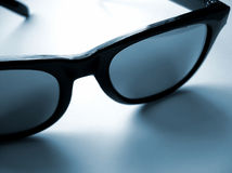 Dark Shades. A cool looking pair of glasses royalty free stock photos