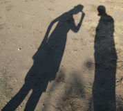 Dark Shadow Tips Hat Toward Another Armless Shadow Stock Image