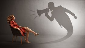Dark shadow yelling to elegant lady. Dark shadow yelling with loudspeaker to elegant young lady stock image
