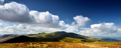 Skiddaw ridge line from Knott. Dark shadows sliding over Skiddaw Forest Royalty Free Stock Photography