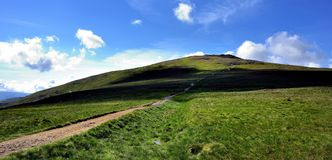 Track up to the summit of Raise. Dark shadows on the track up to Raise Royalty Free Stock Image