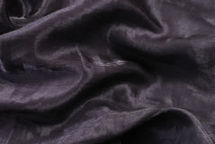 Dark shiny folded textile Stock Images