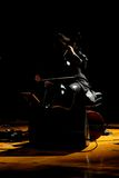 The dark side of music. A cellist plays in dramatic fashion on stage stock photos