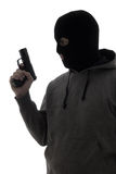 Dark silhouette of criminal man in mask holding gun isolated on Stock Photos