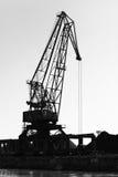 Dark silhouette of industrial port crane. Bulgaria Stock Images