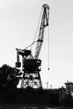 Dark silhouette of industrial port crane. Danube River Stock Photography