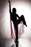 Dark silhouette of a woman dancing Royalty Free Stock Photo