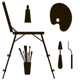 Dark silhouettes easel and painting supplies Stock Photo
