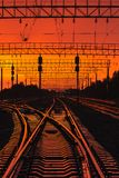 Dark Silhouettes Railway Infrastructure In Dramatic Sunset Backl stock photo