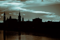 Dark silhouettes of the towers of the old city in Dresden Stock Photo