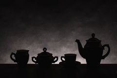 Dark silhouettes of ware for coffee on a gradient background Royalty Free Stock Images