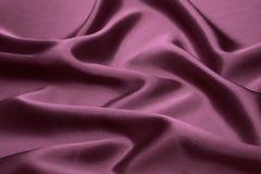 Dark Silk background. A dark purple silk background stock images