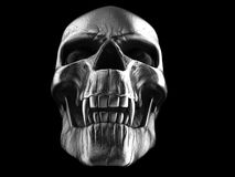 Dark silver demon vampire skull - low angle closeup shot. Isolated on black background royalty free stock image