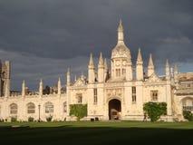 Dark skies frame evening sun over College BuildingsBrooding skies over Cambridge University Stock Images