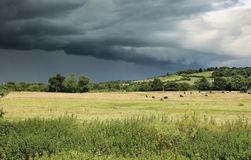 A Summer Storm approaching the Village of Lacock royalty free stock photography