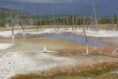 Dark Skies over a Hot Spring Stock Photo