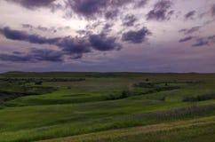 Dark skies over meadows royalty free stock photo