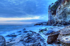 Dark skies over the pirates tower turret after sunset at Victori. A Beach in Laguna Beach, California, USA Stock Photo