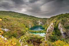 Dark skies Plitvice. Dark clouds over a beautiful autumn view of Plitvice national park in Croatia, a UNESCO world heritage site royalty free stock images