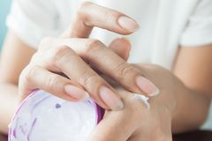 Dark skin woman applying whitening cream on hand, Beauty concept. Allergic testing Stock Images