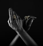 Dark-skinned hand with jewelry on a black background Royalty Free Stock Photo