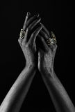 Dark-skinned hand with jewelry on a black background Stock Photography