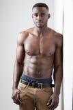 Dark Skinned Male Fitness. Men's Fitness, dark skinned model on white background Royalty Free Stock Photo