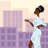 Dark-skinned woman in the city Stock Images