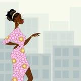 Dark-skinned woman in the city Stock Photo