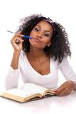 A dark-skinned woman with a note-book Stock Photos