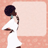 Dark-skinned woman on a pink background Stock Image